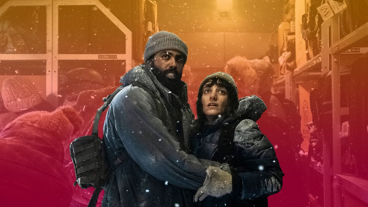 A man and woman dressed in bulky coats and heavy winter gear clutch each other and look fearfully offscreen as snow falls around them in TNT's Snowpiercer series.