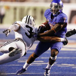 D.J. Harper of the Boise State Broncos escapes Kyle Van Noy of the Brigham Young Cougars during NCAA football in Boise, Thursday, Sept. 20, 2012.