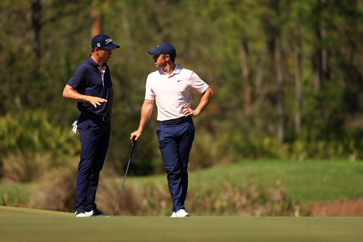 Justin Thomas of the United States talks with Rory McIlroy of Northern Ireland talk on the 11th green during the first round of World Golf Championships-Workday Championship at The Concession on February 25, 2021 in Bradenton, Florida.
