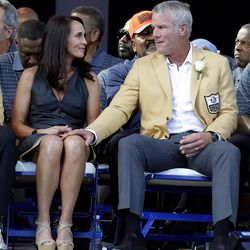 Brett Favre and his wife, Deanna, sit together during the induction ceremony