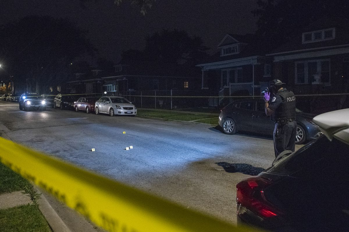 Chicago police investigate the scene where a woman who was shot Thursday night in the 8400 block of South Green.   Tyler LaRiviere/Sun-Times