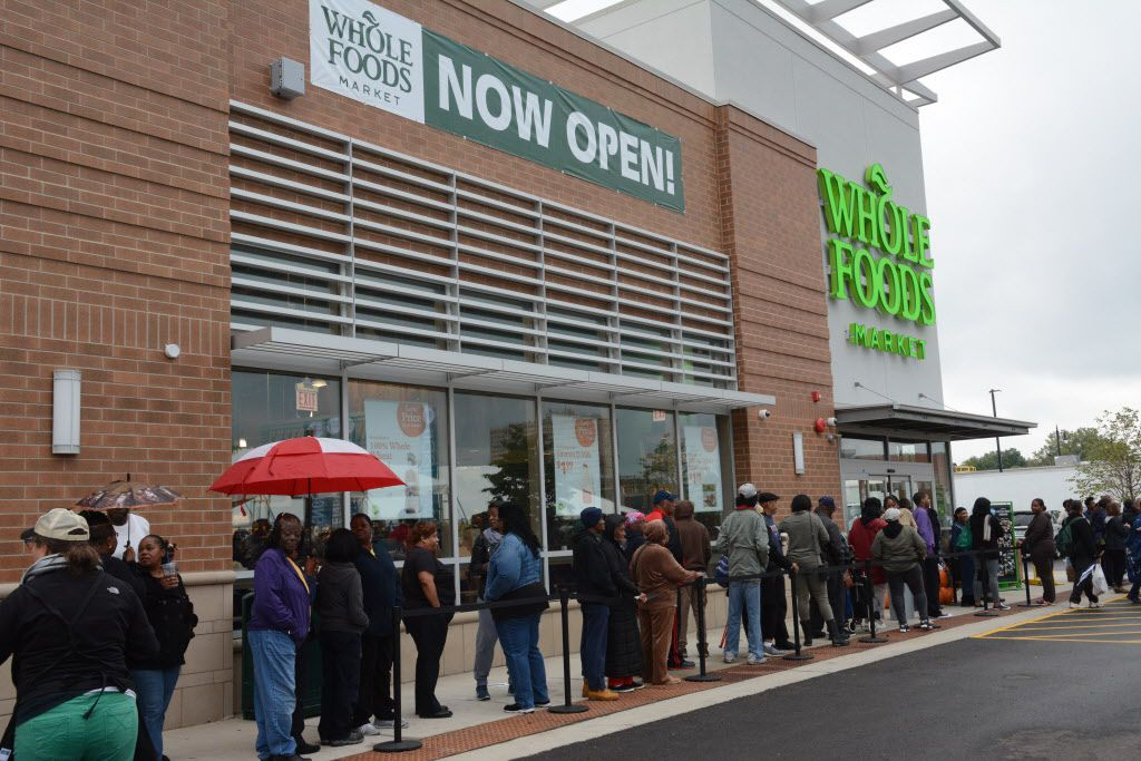 A line of people wait to shop at Whole Foods at the Englewood Square shopping center in September. | Sun-Times file photo
