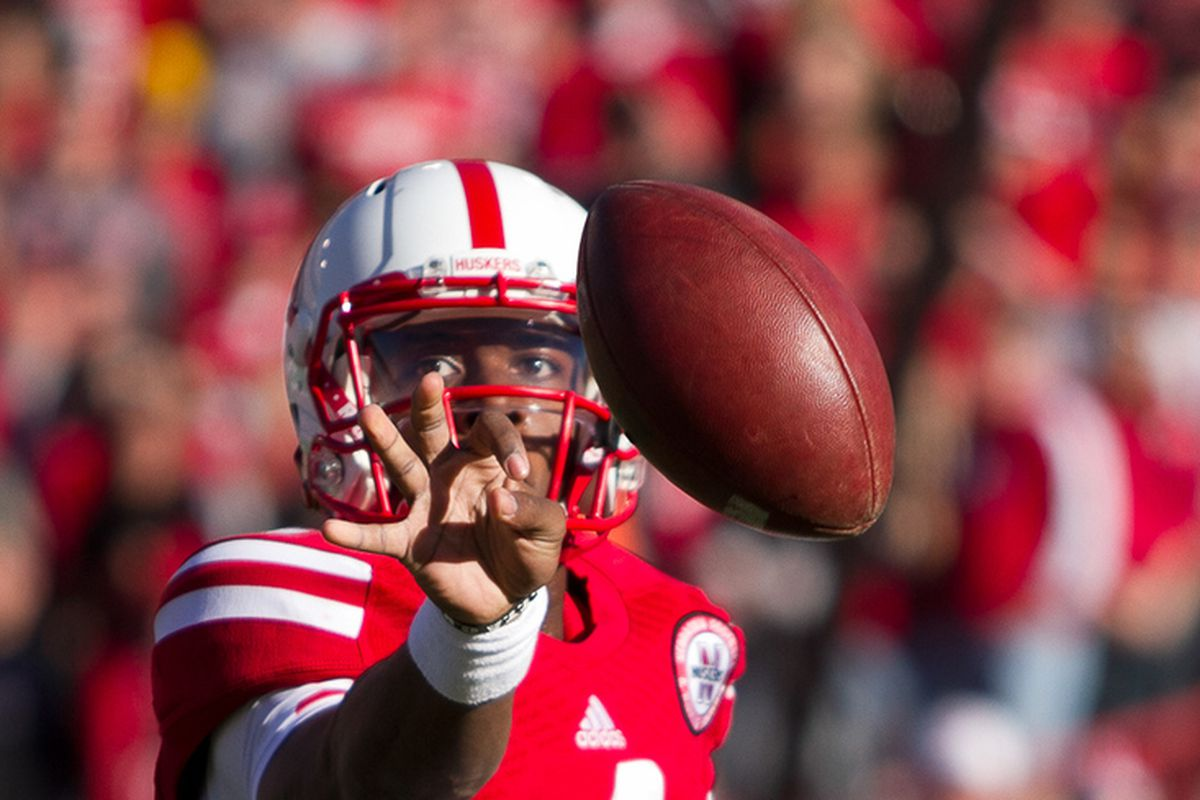 Nebraska quarterback Tommy Armstrong Jr pitches the football against Northwestern.