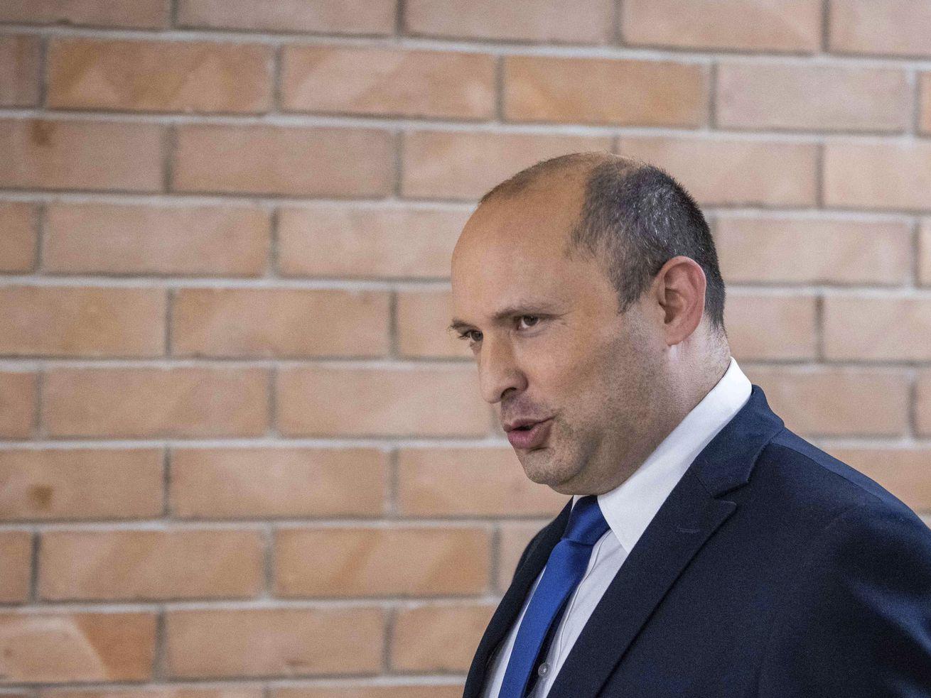 Yemina party leader Naftali Bennett arrives to speaks to the Israeli Parliament in Jerusalem, Sunday, May 30, 2021.