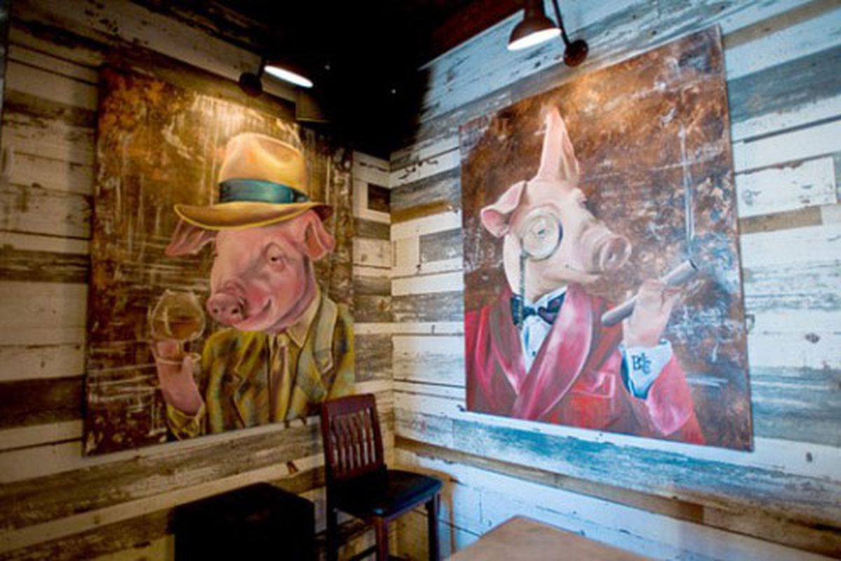 Whimsical porcine art graces the walls throughout