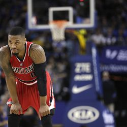 Portland Trail Blazers' Damian Lillard rests during the second half of an NBA basketball game against the Golden State Warriors Saturday, Dec. 17, 2016, in Oakland, Calif. (AP Photo/Marcio Jose Sanchez)