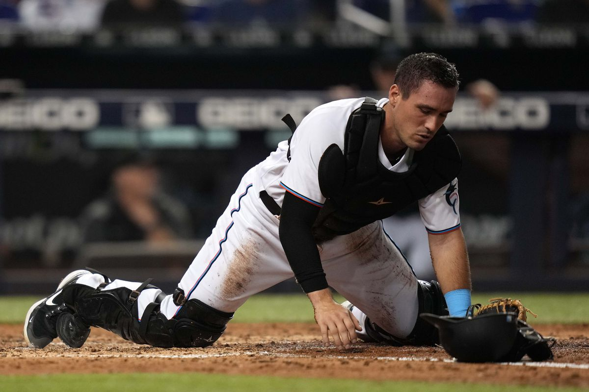 Miami Marlins catcher Nick Fortes (84) reacts after colliding with Washington Nationals shortstop Alcides Escobar (3) at the plate in the 6th inning at loanDepot park