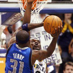 Utah Jazz center Al Jefferson (25) tries to defend Dallas Mavericks guard Jason Terry (31) as the Utah Jazz and the Dallas Mavericks play Monday, April 16, 2012 in Salt Lake City.