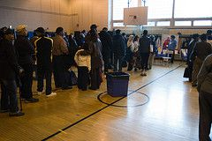Voters wait in line at PS 175 in Harlem this morning (via Flickr)