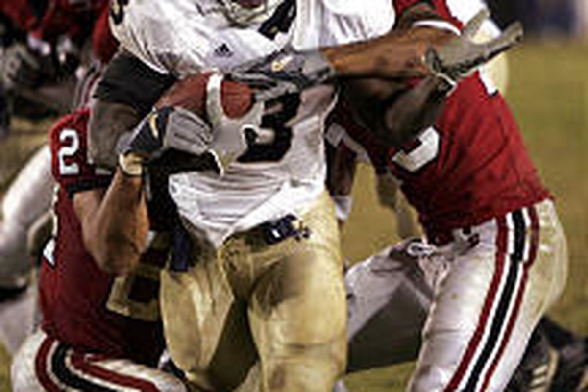 Notre Dame running back Darius Walker drives for the game-winning touchdown as Stanford defensive backs Brandon Harrison, right, and Trevor Hooper, left, try to stop him in Notre Dame's victory Saturday.