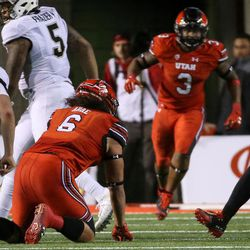 Utah Utes linebacker Cody Barton (30) recovers a fumble from Colorado Buffaloes quarterback Steven Montez (12) at Rice-Eccles Stadium in Salt Lake City on Saturday, Nov. 25, 2017.