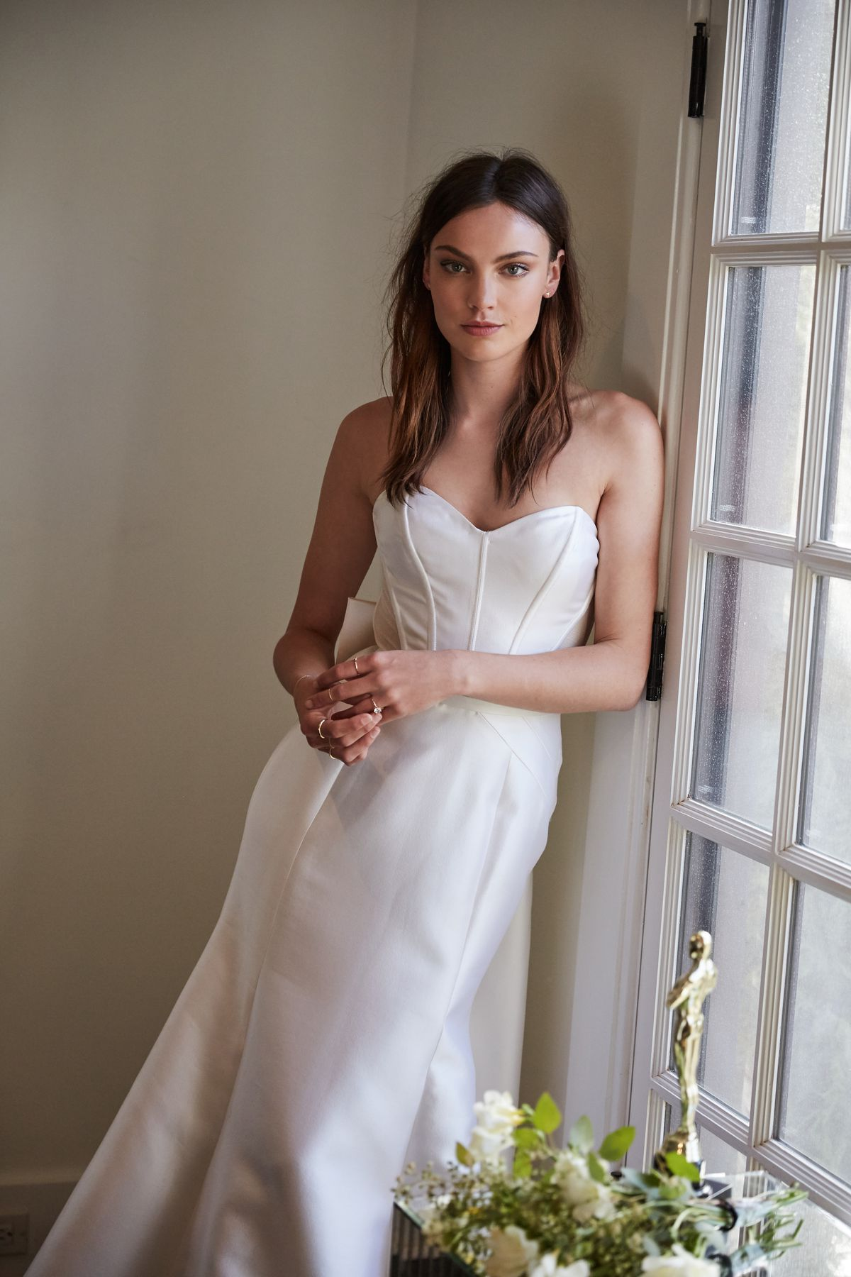 Woman wearing white strapless wedding gown.