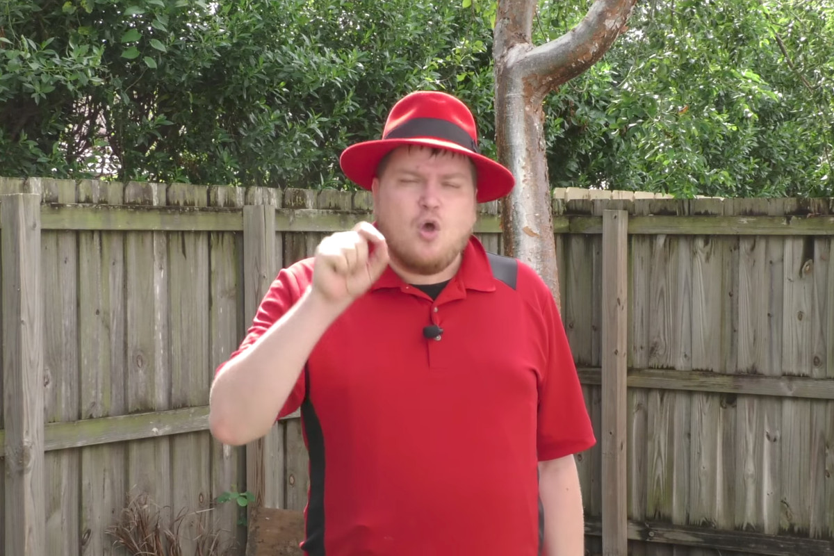 Tom Vasel, wearing a red fedora, rips into local game shops in a segment of an October video on YouTube.