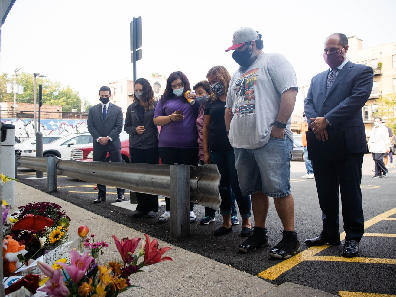 Israel Alvarado III, second from right, fiance of Olga Maria Calderon, and family members gathered Wednesday at a memorial for Calderon outside Walgreens at 1372 N. Milwaukee Ave. in Wicker Park.