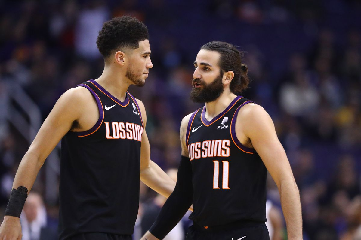 Phoenix Suns guard Devin Booker with Ricky Rubio against the Minnesota Timberwolves in the second half at Talking Stick Resort Arena.