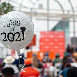 A celebratory balloon floats in the audience of the Simon Youth Academy graduation Thursday at the Indianapolis Artsgarden.