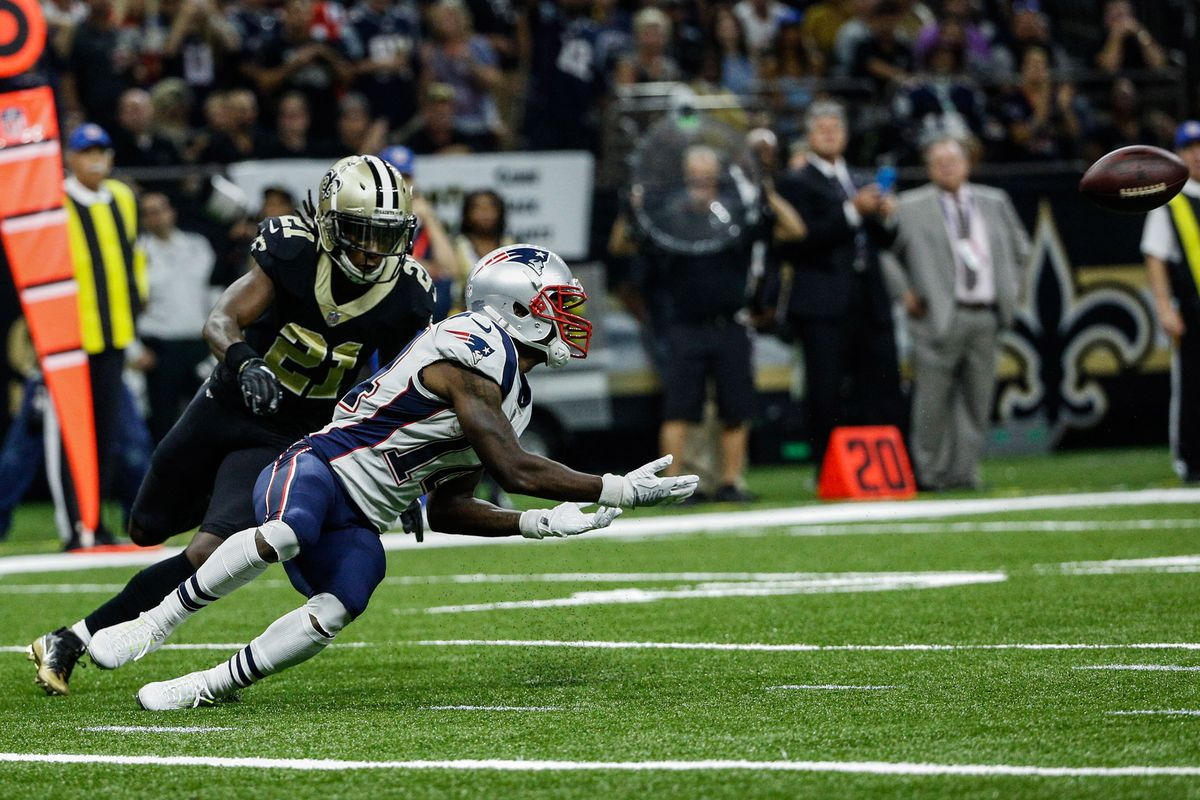 NEW ORLEANS, LA - New England Patriots wide receiver Brandin Cooks (14) catches a pass as  New Orleans Saints cornerback De'Vante Harris (21) covers during the  second quarter of a game at the Mercedes-Benz Superdome.
