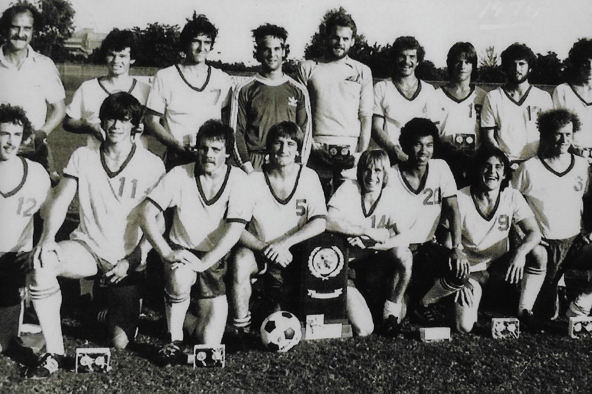 Fresh from their three-overtime upset for 1978 NCAA Division II championship, Seattle Pacific poses with its first trophy.
