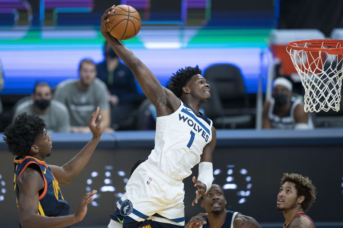 Minnesota Timberwolves guard Anthony Edwards (1) dunks the basketball against Golden State Warriors center James Wiseman (33) during the first quarter at Chase Center.