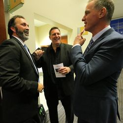 Jason Buck, Trevor Matich and Jim Herrmann talk prior to the memorial for former BYU football coach Lavell Edwards at the Provo Convention Center on Friday, Jan. 6, 2017.