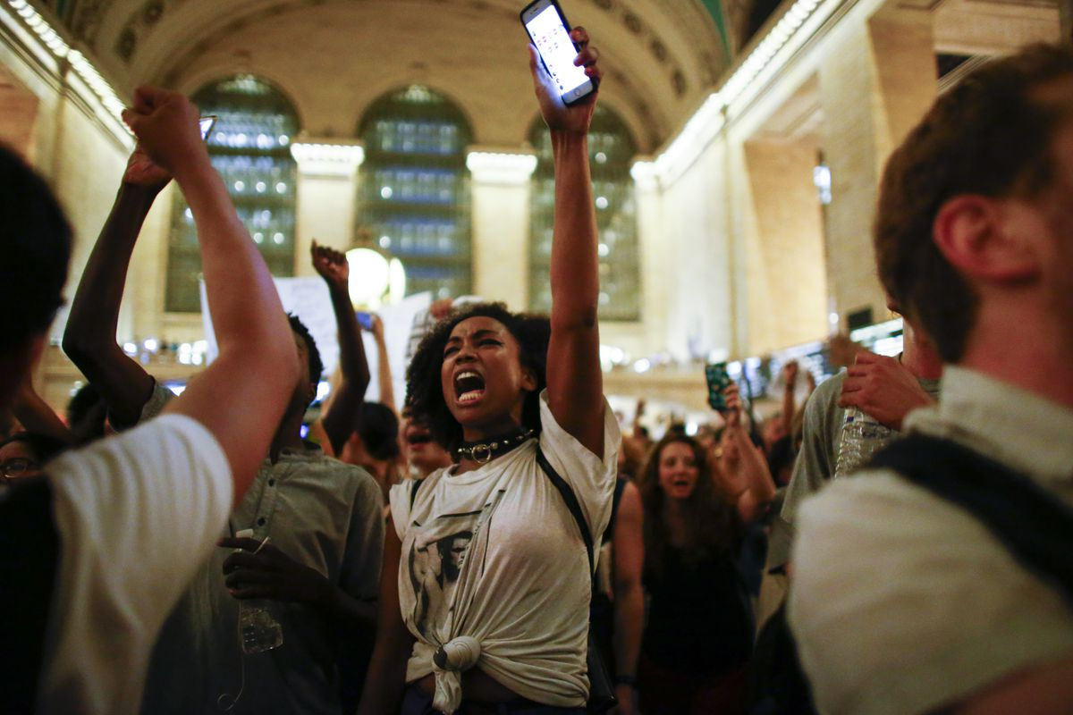 People take part in a protest in Grand Central Station on July 8, 2016, in New York City.