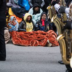 Spectators at the Thanksgiving Day Parade watch as marching bands pass by on November 22, 2018   Max Herman/For the Sun-Times