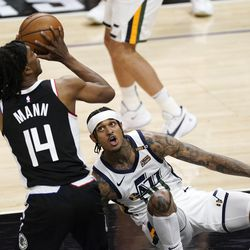 Los Angeles Clippers guard Terance Mann, left, shoots as Utah Jazz guard Jordan Clarkson falls during the second half of Game 3 of a second-round NBA basketball playoff series Saturday, June 12, 2021, in Los Angeles. (