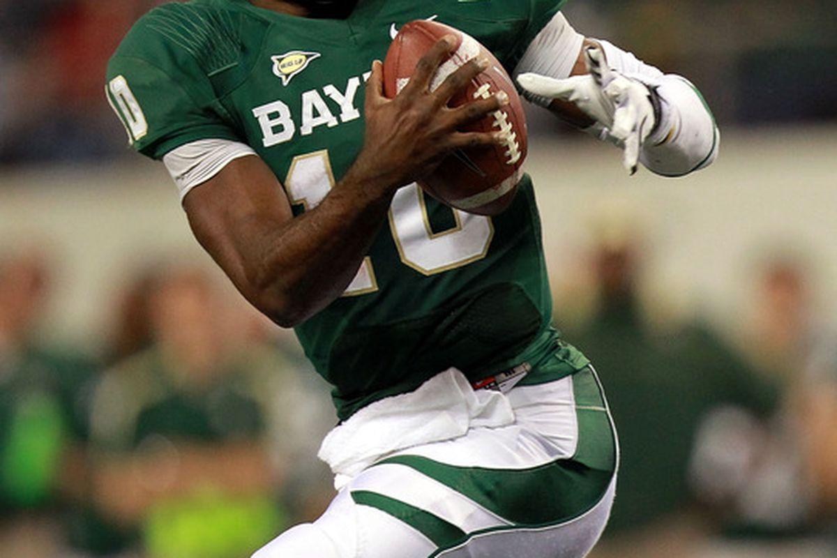 ARLINGTON, TX - NOVEMBER 26:  Robert Griffin III #10 of the Baylor Bears runs with the ball against the Texas Tech Red Raiders at Cowboys Stadium on November 26, 2011 in Arlington, Texas.  (Photo by Ronald Martinez/Getty Images)