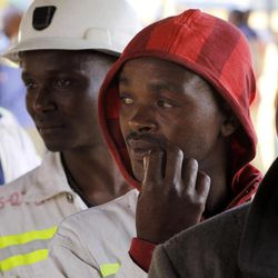 Miners return to work at the Lonmin Platinum mine after Lonmin resolved a five-week strike by agreeing to pay raises of up to 22 percent, in Marikana, Rustenburg, South Africa, Thursday, Sept. 20, 2012.