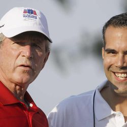 Former President George W. Bush, left, talks with talks with his nephew George P. Bush during the Bush Center Warrior Open in Irving, Texas, Monday, Sept. 24, 2012.  The Warrior Open is a two-day golf tournament featuring members of the U.S. Armed Forces who were severely wounded during the global war against terrorism.
