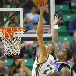 Utah's Rudy Gobert goes high for a rebound over Warriors' Dewayne Dedmon as the Utah Jazz and the Golden State Warriors play Tuesday, Oct. 8, 2013 in preseason action at Energy Solutions arena in Salt Lake City.