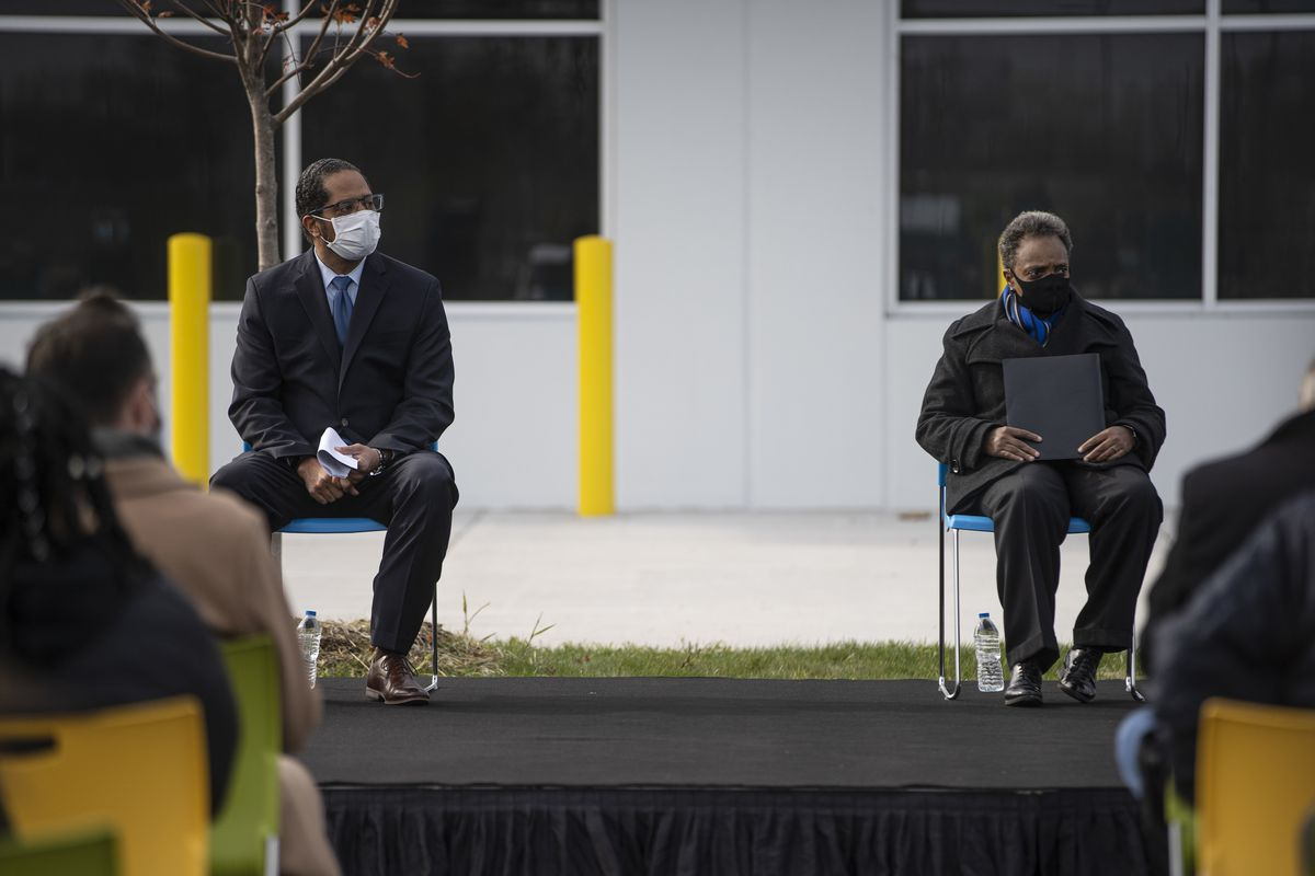 Ald. AnthonyBeale (9th), left, and Mayor Lori Lightfoot, listen to a speaker at the opening ceremony of Chicago's first Amazon Delivery Station in Pullman in October.