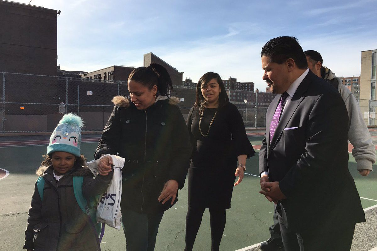 Chancellor Richard Carranza greeted families outside Concourse Village Elementary School in the Bronx on his first official school visit.