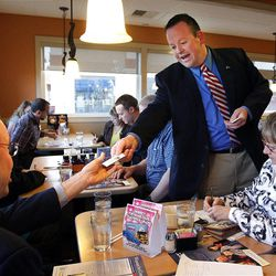 Carl Wimmer, a candidate for the 4th Congressional District, hands his cards to delegates at IHOP in West Jordan, Wednesday, April 4, 2012.