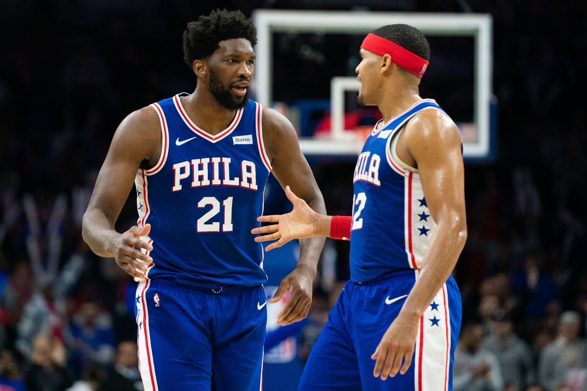 Philadelphia 76ers center Joel Embiid reacts with forward Tobias Harris after scoring against the Denver Nuggets during the third quarter at Wells Fargo Center.