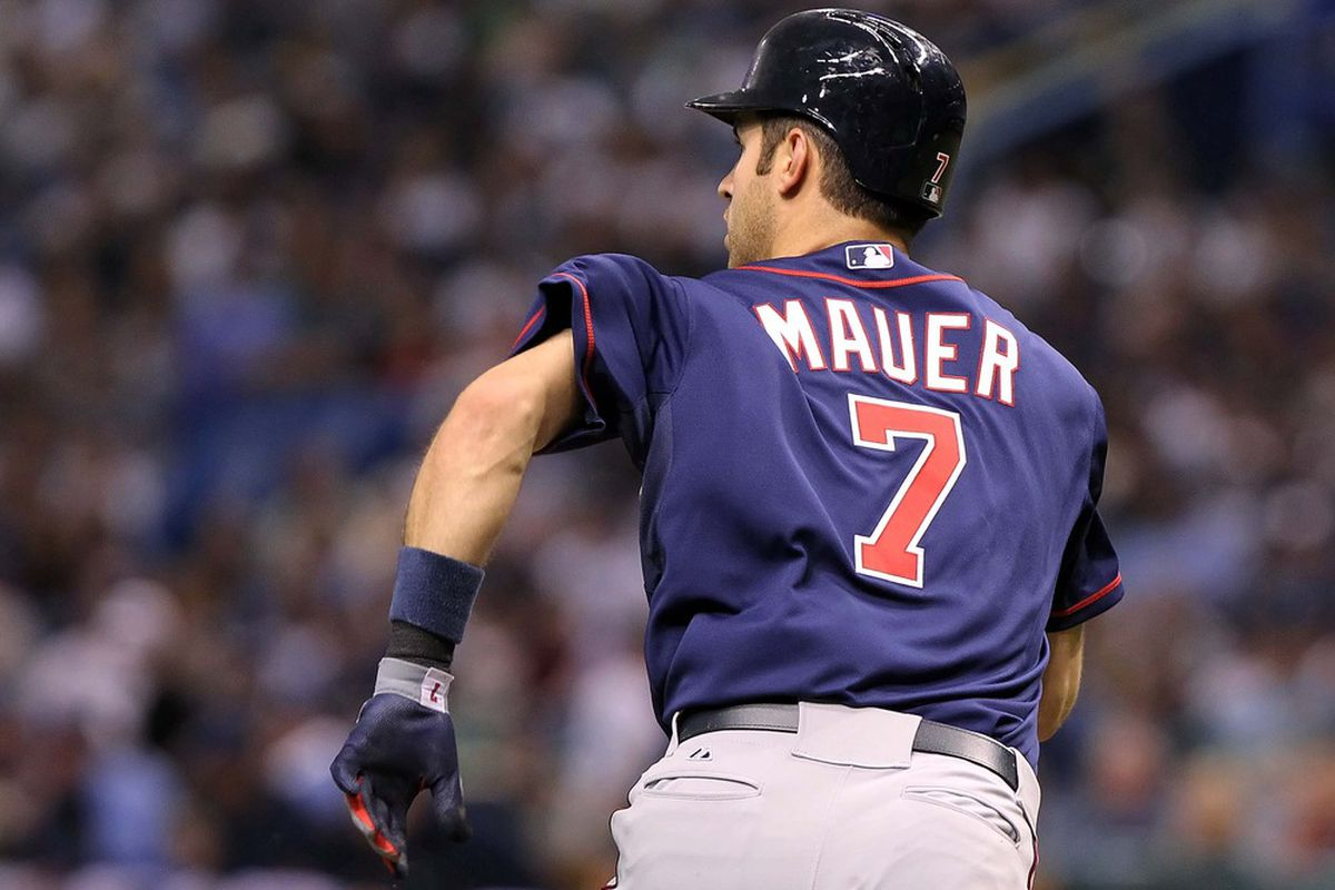 April 21, 2012; St. Petersburg, FL, USA; Minnesota Twins catcher Joe Mauer (7) hits a single in the fourth inning against the Tampa Bay Rays at Tropicana Field. Mandatory Credit: Kim Klement-US PRESSWIRE