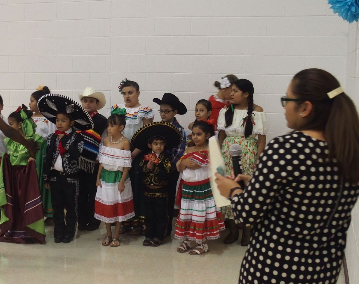 Palacio, right, coordinates activities during a Hispanic Heritage Month event for Shelby County Schools.