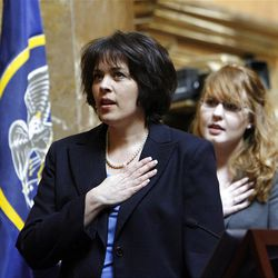 Speaker of the House, Rebecca D. Lockhart, recites the Pledge of Allegiance at the beginning of the day at the Utah Capitol in Salt Lake City, Utah Wednesday, Feb. 16, 2011. Behind her is Hannah Marchant, an intern.
