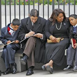 The Fernando Cruz family enjoys listening to conference outside during The Church of Jesus Christ of Latter-day Saints' Saturday afternoon session of the 183rd Annual General Conference Saturday, April 6, 2013, in Salt Lake City.