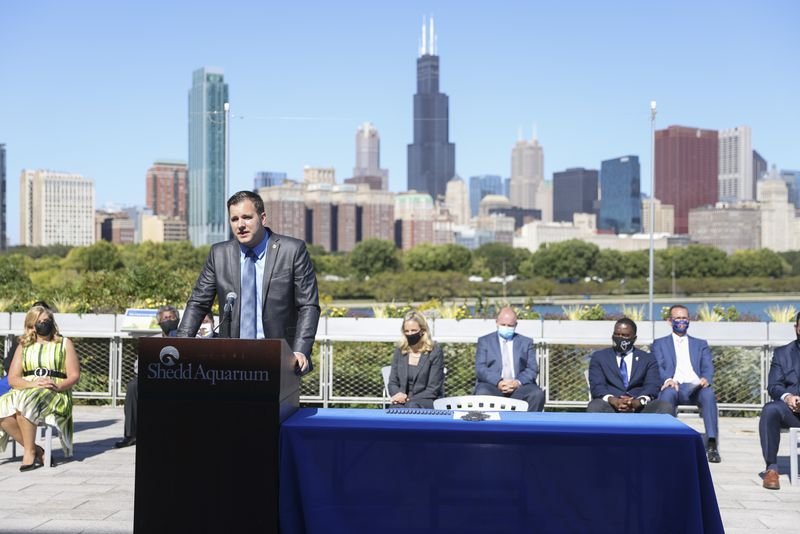 State Rep. David Welter speaks about overcoming political differences in order to pass the Climate and Equitable Jobs Act at the Shedd Aquarium on Wednesday.