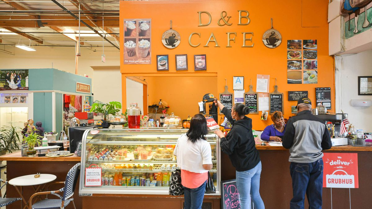 An orange stall for soul food in Lancaster California has customers waiting at it.