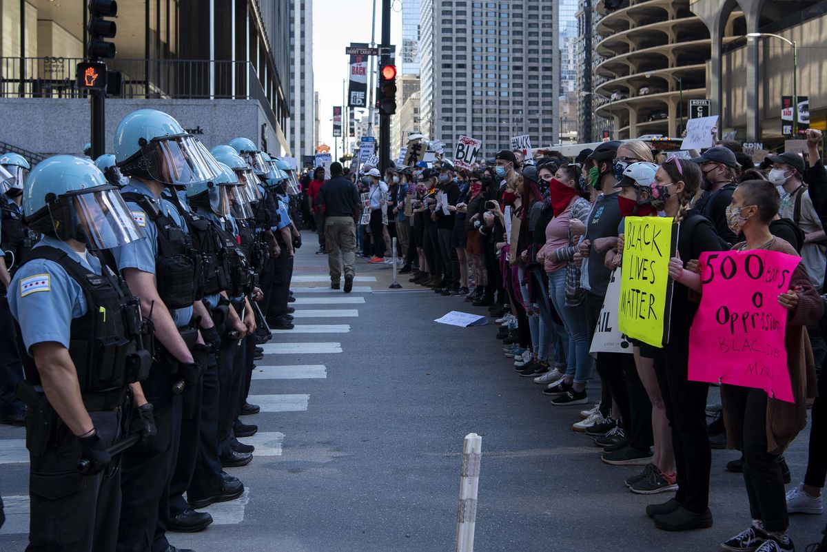 Protesters squad off with Chicago police on Kinzie and State Street, during a protest for George Floyd, Saturday, May 30, 2020.