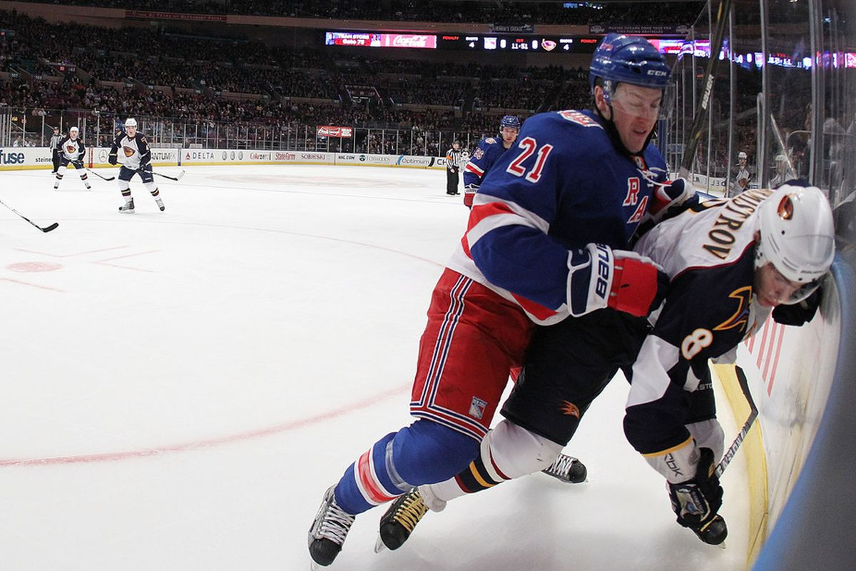 NEW YORK, NY - APRIL 07:  Derek Stepan #21 of the New York Rangers checks Alexander Burmistrov #8 of the Atlanta Thrashers during their game on April 7, 2011 at Madison Square Garden in New York City, New York.  (Photo by Al Bello/Getty Images)