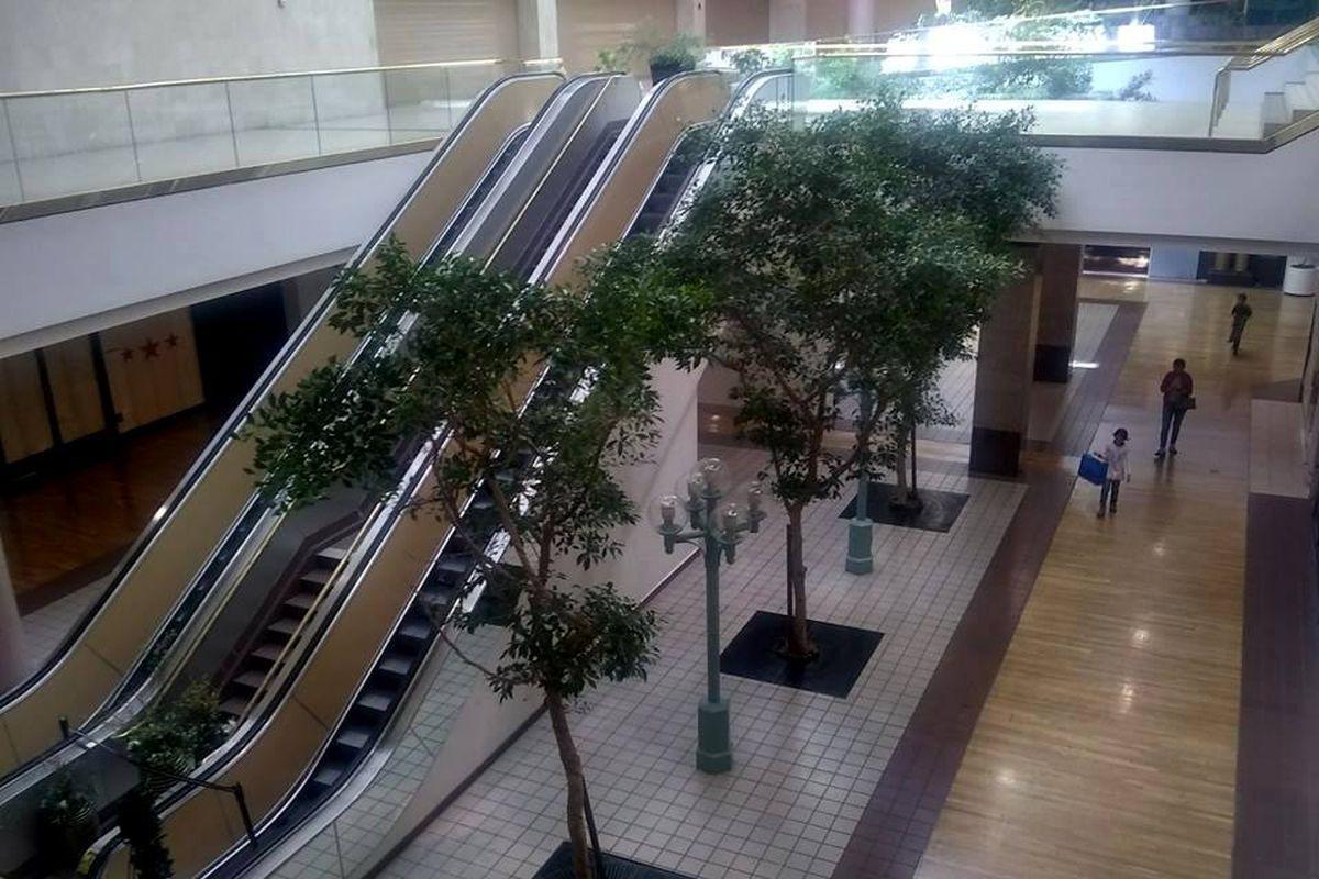Empty escalators and shops at Vallco mall.