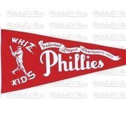 "<a href=""http://www.mitchellandness.com/Products/1950-Whiz-Kids-Wool-Felt-Philadelphia-Phillies-Pennant__Y134Z-MTC-8PPHA3-A.aspx"">1950 Whiz Kids Wool Felt Philadelphia Phillies Pennant</a>, $20 at Mitchell & Ness"