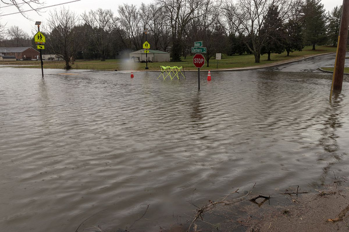 Flash floods caused by heavy rains shutter streets in Overton County, home to one of many Tennessee districts that have closed schools in February due to flooding or illness.