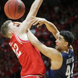 Utah Utes forward Jakob Poeltl (42) defends Brigham Young Cougars center Corbin Kaufusi (44) as Utah and BYU play in the Huntsman Center in Salt Lake City Wednesday, Dec. 2, 2015.