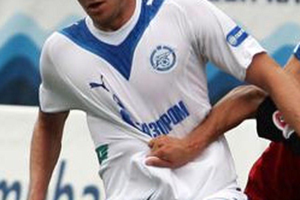 Zenit St. Petersburg defender Nicolas Lombaerts tussles for possession in a match against FC Khimki.