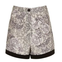 """<a href=""""http://www.topshop.com/webapp/wcs/stores/servlet/ProductDisplay?beginIndex=0&viewAllFlag=&catalogId=33057&storeId=12556&productId=11052045&langId=-1&categoryId=&searchTerm=reclaim%20to%20wear&pageSize=200"""">Grey Floral Printed Shorts</a>, $68"""