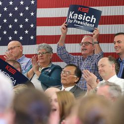 Crowd members cheer as Ohio Gov. John Kasich speaks at a Town Hall meeting in the Guest House at the University of Utah Friday, March 18, 2016.